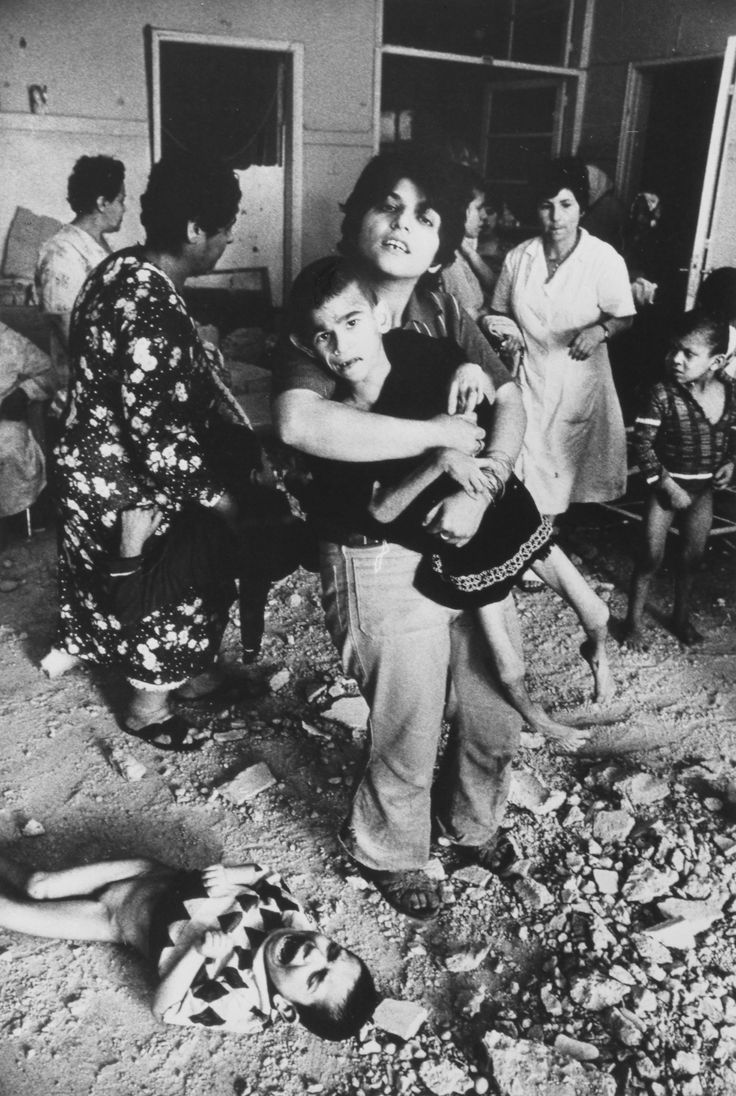 The inhabitants of a mental hospital in Sabra Beirut move each other after Israeli shellfire during the Lebanese Civil War 1982 [2378x3544] [OS] http://ift.tt/2euuDwp