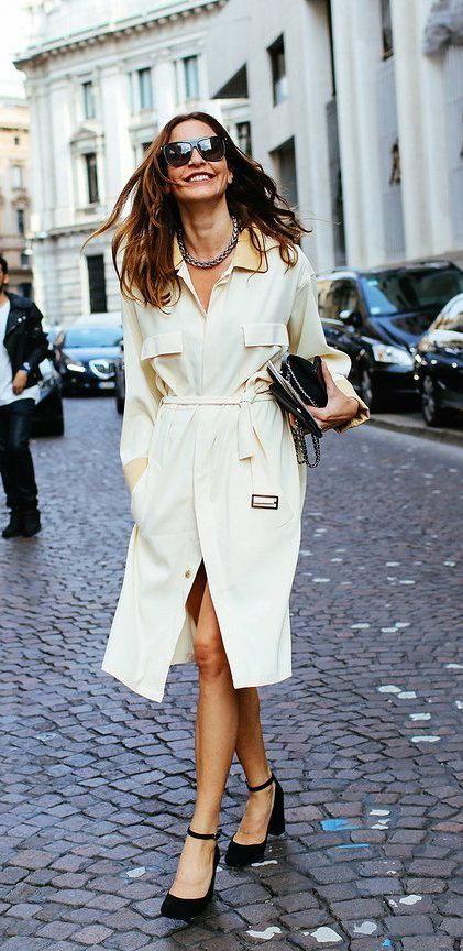 Ece Sukan in a cream silk Umit Benan belted coat