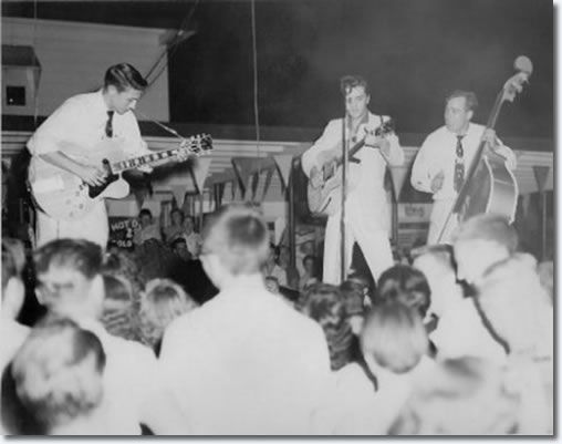July 15, 1955 : Joy Drive-In Theatre : Minden, LA       On July 15, 1955, Elvis, Scotty and Bill performed at the Drive-In. They were booked by John Cobb who regularly attended the Louisiana Hayride and had first seen them perform there. For a stage, Cobb borrowed a flatbed truck from Almond's Feed & Seed Co. in Minden and parked it in front of the snack bar (concession stand).  They were said to have been booked for two appearances but only did the one and were paid $25 for it.