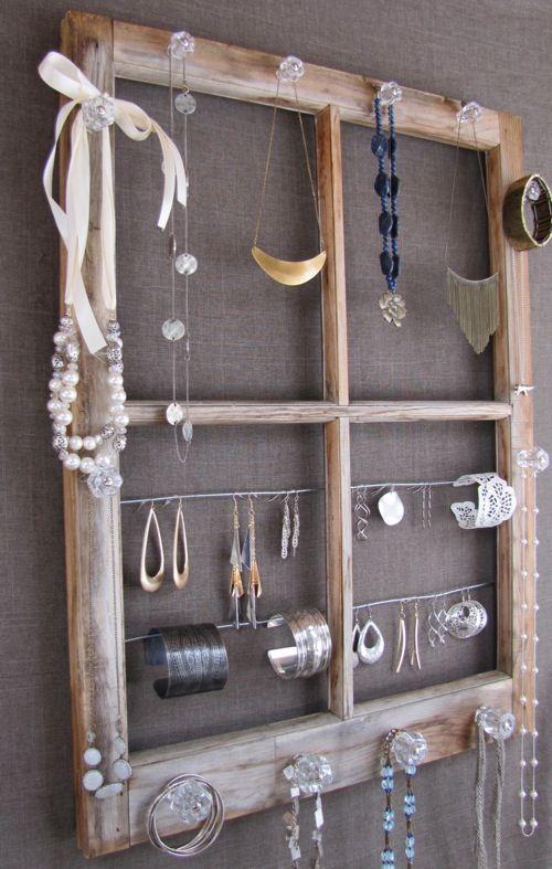 Jewlery Organizer Window... I like the idea of using knobs screwed into wood, not necessarily a window