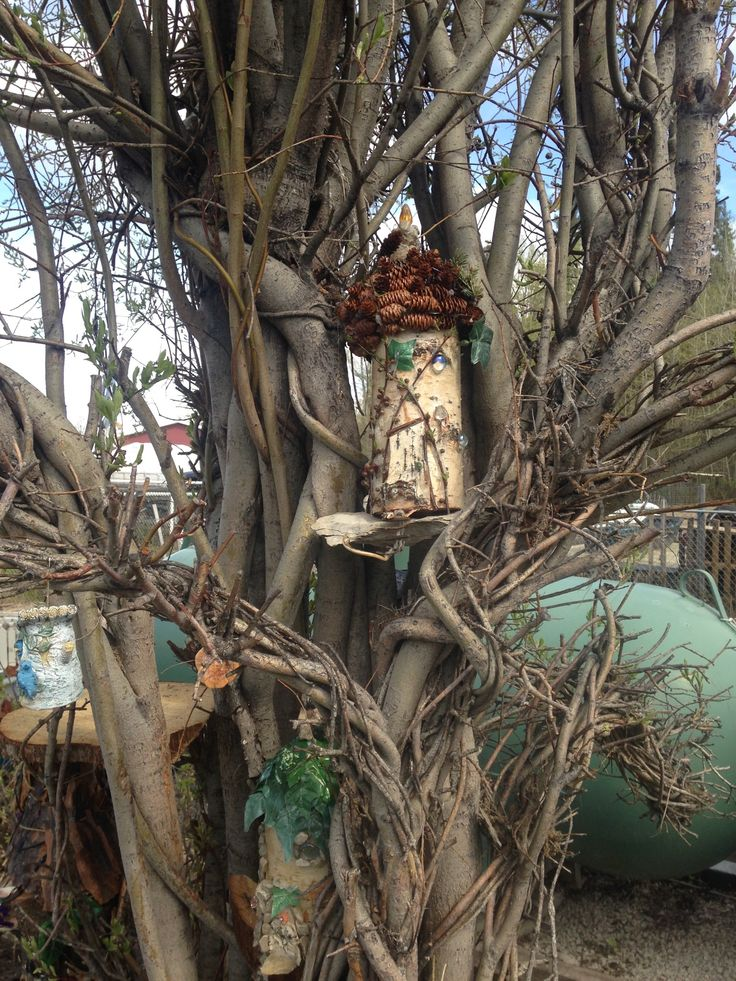 Woolland fairy houses made from birch logs.