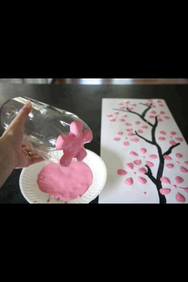 Awesome paint flowers idea! Just need a empty 1 litter bottle.