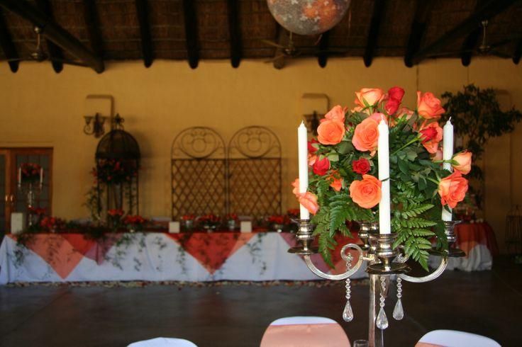 Beautiful #Orange #Roses enclosed by #White #Candles wwwthabatshwene.co.za