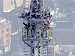 Cheers erupt as spire tops One World Trade Center - May 10, 2013