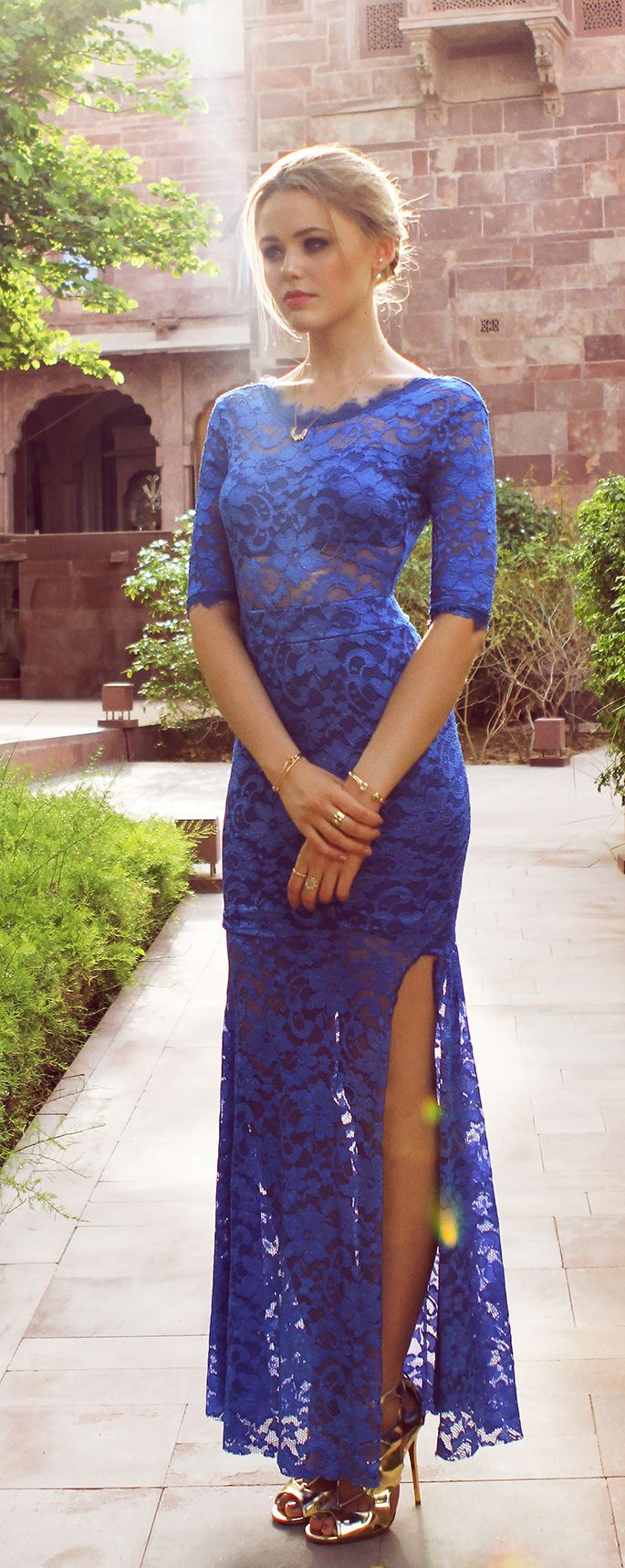 Kristina Bazan is wearing a blue lace dress from Sheinside and golden shoes from Jimmy Choo