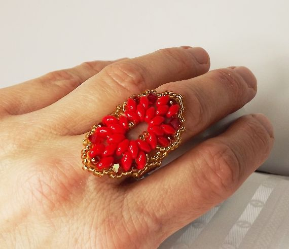 The ring made from red colour superduo, 4mm swarovski bicons and seed beads.