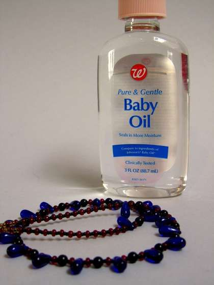How to untangled a chain necklace:  Lay chain on a flat service and place a few drops of baby oil on snag. Then take a straight pin and carefully work out the knot. You can also forgo the oil and use baby powder or flour.
