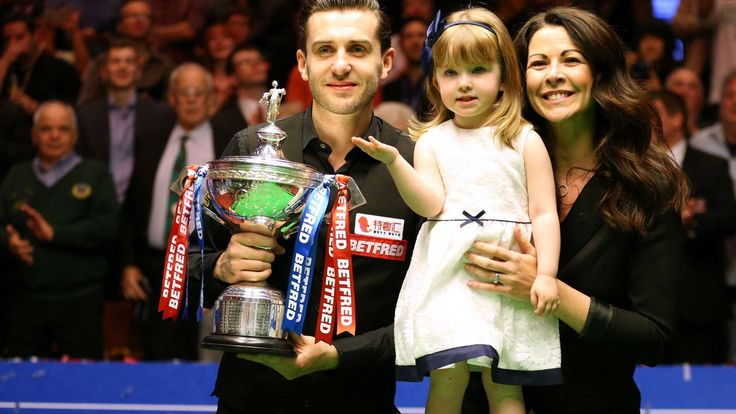 Mark Selby beats John Higgins 18-15 to win his third world title