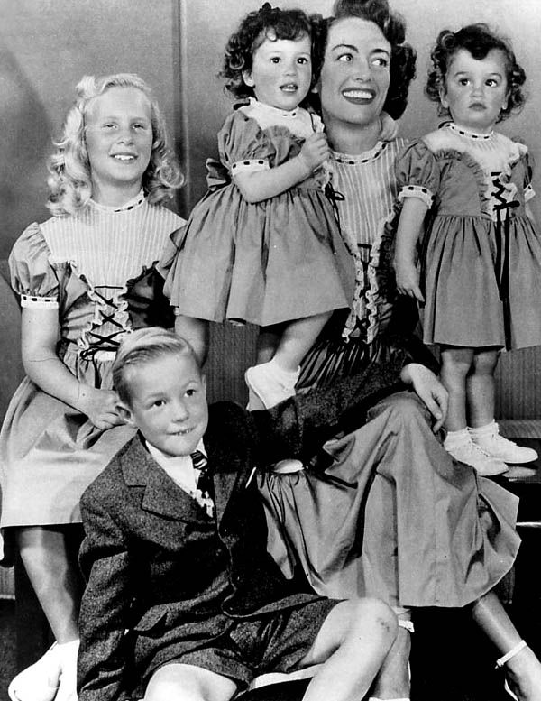 Joan Crawford with 4 of her (adoptive) children. A 5th was reclaimed by the birth mother. Her oldest daughter wrote an acrimonious memoir after Joan's death in 1977; titled 'Mommy Dearest', Christine alleged a lifelong pattern of child abuse. She and her brother Chris had been disinherited by Joan years before. Harsh to smack a bitch when she's in the ground.