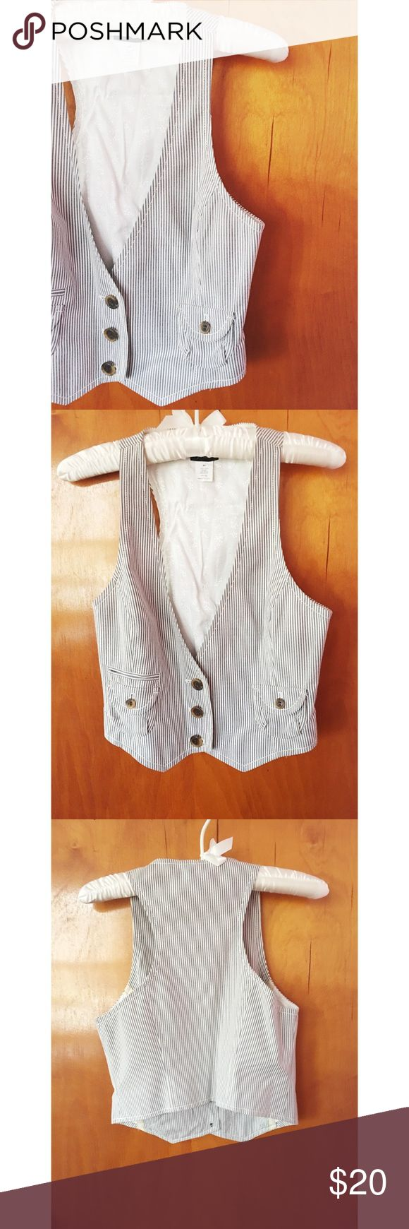 J.Crew Vest This J. Crew Vest is in great condition and a size X-Small.  It is a navy blue and white pinstripe. Outer fabric is cotton and lining is a rayon and acetate blend. Super cute J. Crew Jackets & Coats Vests