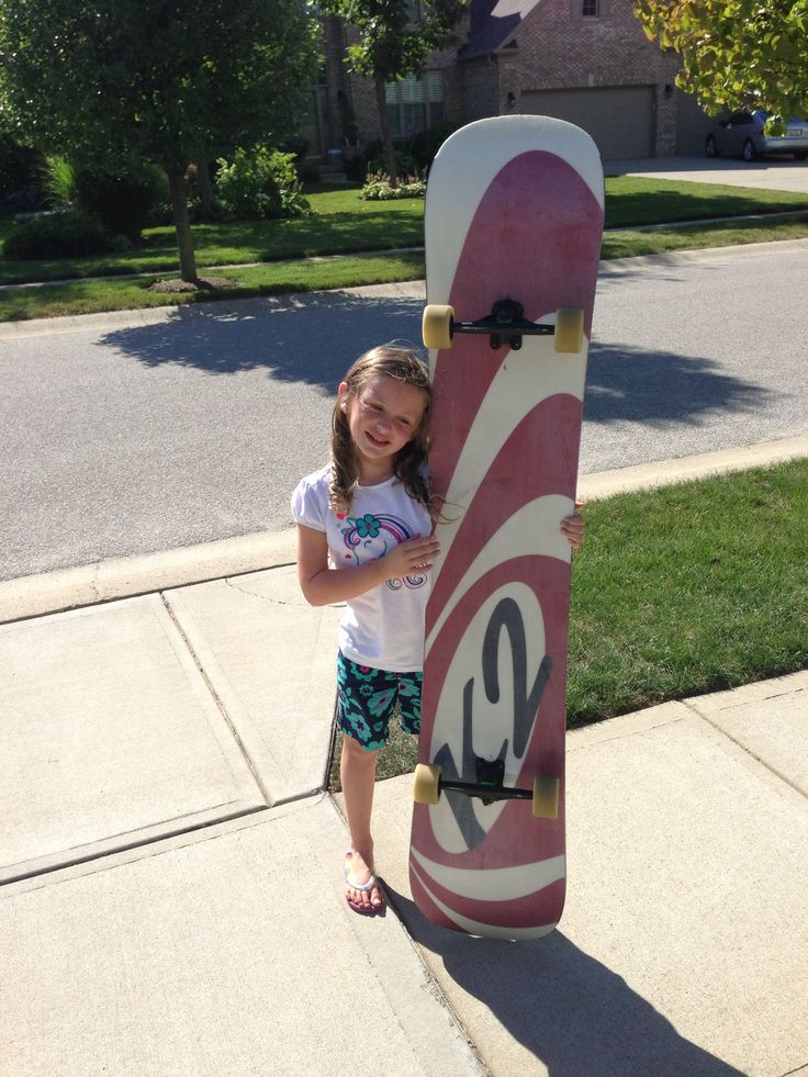 Build a giant skateboard: one old snowboard and some longboard trucks and wheels... It can hold 5-6 kids or one body surfer