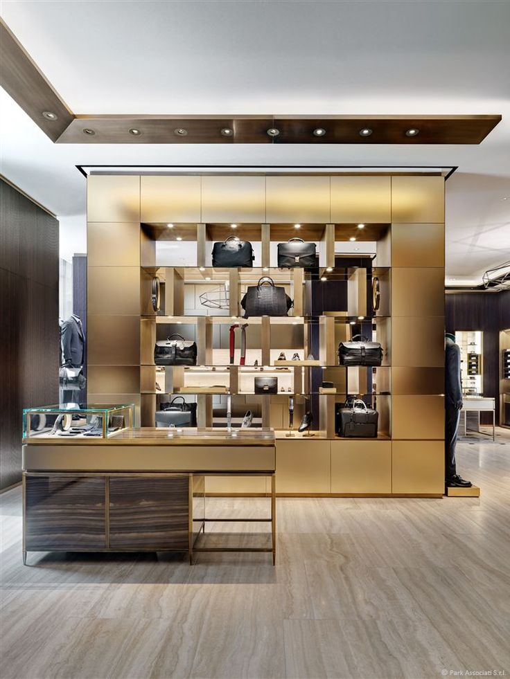 """A """"Brass brilliance"""" display case in the Brioni flagship store in Milano desiged by Park Associati."""