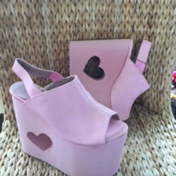 Shop Women's YRU Pink size Various Platforms at a discounted price at Poshmark. Description: Cute YRU by Nikki Lipstick Platform Sandals with heart cut outs in the heel. Bubblegum pink and so comfortable even though they are 6.5 inches high! Sold out in store! Only a couple left...... tags: DOLLS KILL UNIF SANRIO HELLO KITTY KAWAII. Sold by uneedthistoo. Fast delivery, full service customer support.