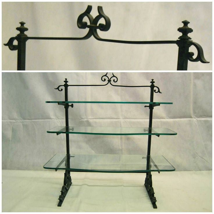 Antique Iron Display Shelf at D and A Binder | This beautiful little glass shelving unit is available now at Binder's! With ornate curved details and 3 serpentine-esque glass shelves this beauty is ready to display your jewellery glasses smalls collectables foodstuffs and more. We believe this is a 1920's era shelving unit and have kept it in it's lovely original condition - however if you'd like us to polish it that's also an option. Currently 780 on Selling Antiques! Interested? Contact…