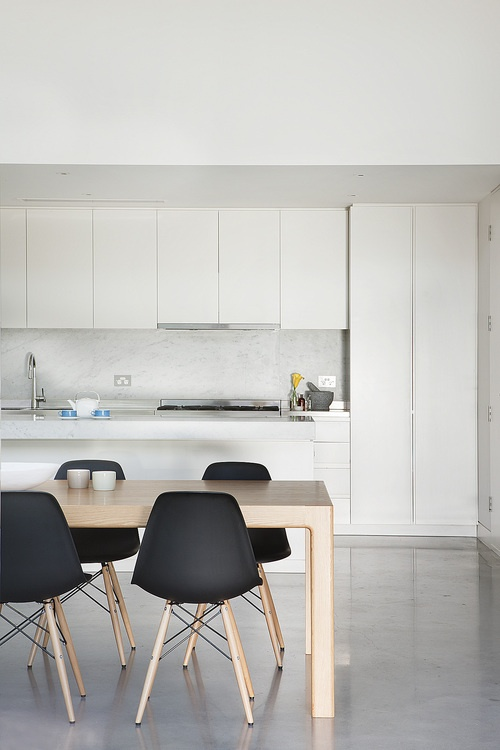 white kitchen + black eames chairs
