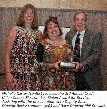 Athletics: Credit Union Cherry Blossom Run Awards 2017 Les Kinion Outstanding Service Award To Michelle Carter In Recognition Of Her Tireless Dedication To The Runner's Rite Of Spring