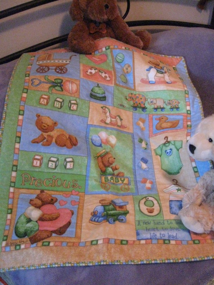 This little cot quilt was a panel which I ditch stitched and made up for a gorgeous little boy called Logan.
