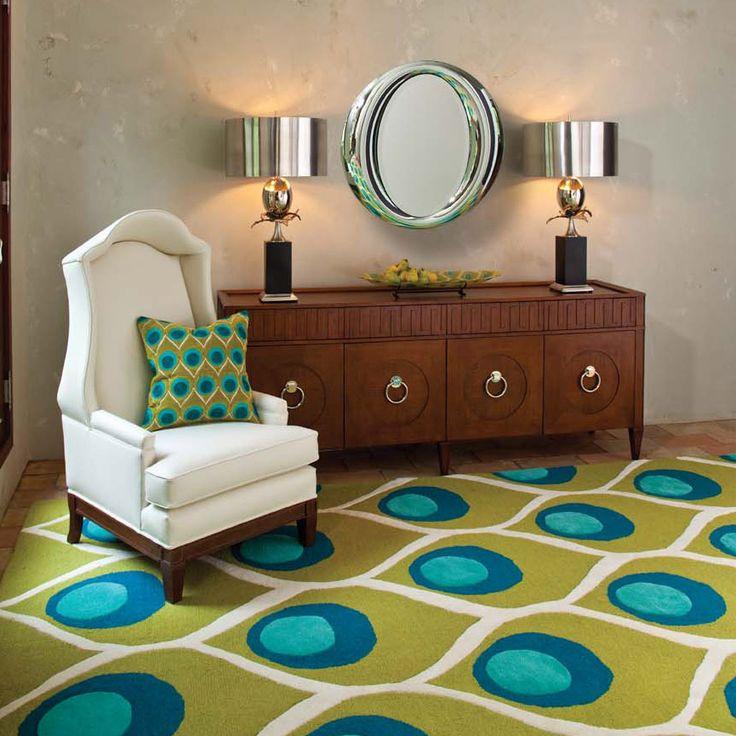 Peacock rug, pillow, decor, but that mirror! Love that mirror