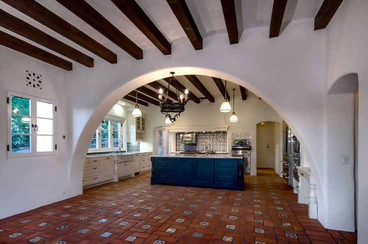 Wall to wall arch in traditional Spanish Revival style kitchen.