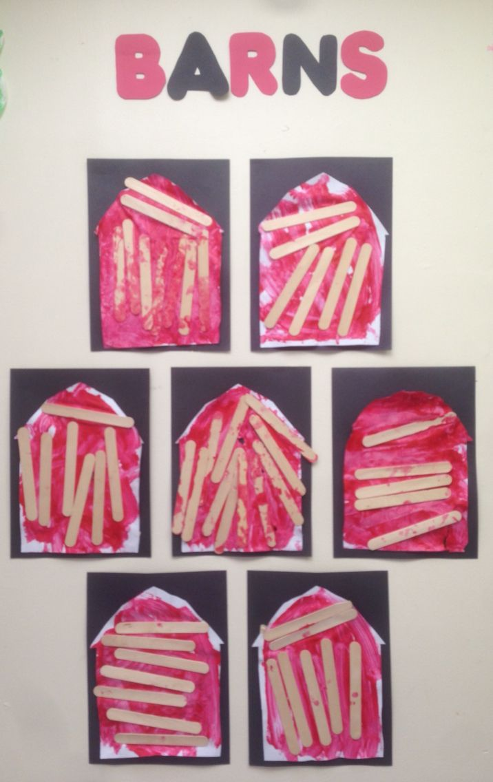 Free expression barns on the farm. Toddler children painted with red paint and glued on an assortment of Popsicle sticks.
