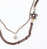 """Long Metal Flower and Bead Necklace - Metallic flowers in shimmery chocolate hues doll up this mixed-media charmer with just the right amount of shine. Lobster claw clasp. 18"""" drop."""