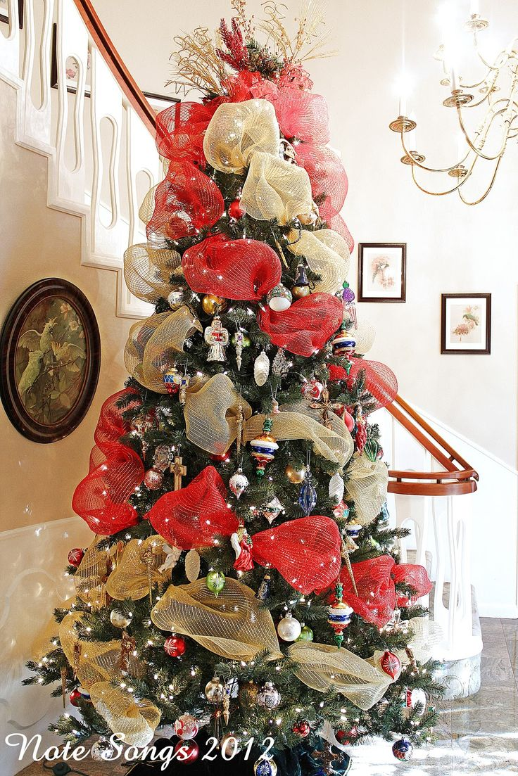 Red And Gold Christmas Tree Decorating Ideas - Decorating a christmas tree with deco mesh fell in love with deco mesh last year