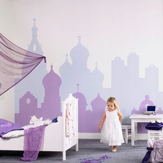 City skyline wall mural.  I love the use of 2 shades of the same color for background/foreground.  Could do this with other concepts too--a horizon, mountains, trees, a more modern skyline, etc.
