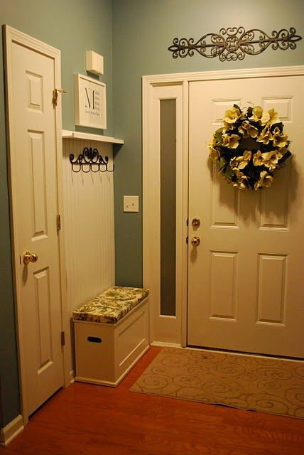 We have just enough space behind our front door to do something similar.  Adding to never-ending home to-do list...