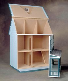 No detail has been overlooked in the creation of this elegant Front Opening Federal Dollhouse Kit. An excellent addition to your Federal collection, this wooden-shingled home features 10 rooms with a