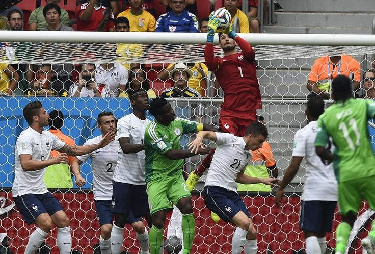 France's goalkeeper Hugo Lloris (top) saves the ball during their 2014 World Cup round of 16 game against Nigeria at the Brasilia national stadium in Brasilia June 30, 2014.