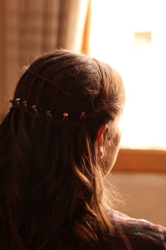 braided hair for the bride, with pink crystals