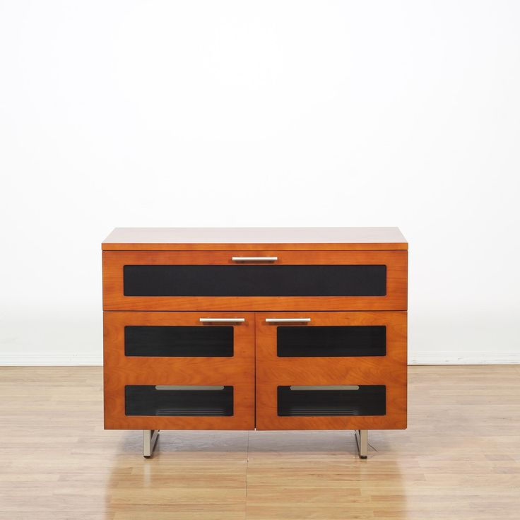 This contemporary media cabinet is featured in a wood with a glossy cherry finish. This entertainment center has 1 large drawer, glass panel doors with interior cabinets and a metal sled base. Sleek and stylish tv stand perfect for storing electronics! #contemporary #storage #cabinet #sandiegovintage #vintagefurniture