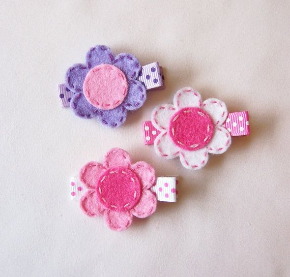 I am starting to like felt more... have seen some nicely done items lately. This etsy shop has very cute ideas