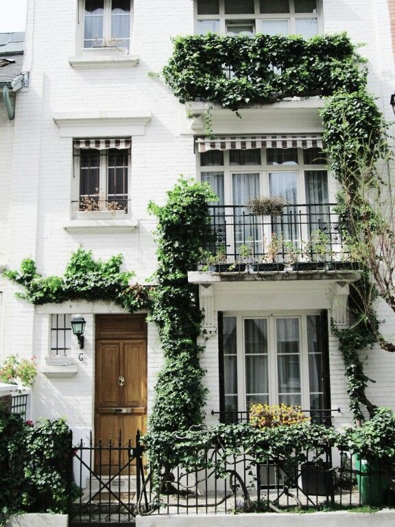 White Three Story Townhouse Townhome Apartment With Lots Of Windows Striped Awnings Wooden Front Door Black Iron Gat House Exterior Paris Home Terrace Decor
