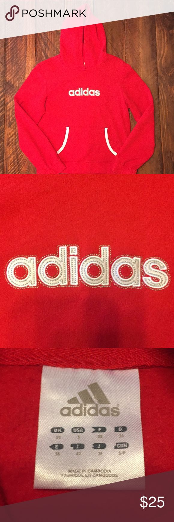 """Red Adidas hoodie in small Red Adidas hoodie in small.  Embroidered """"adidas"""" logo in excellent shape.  Kangaroo pocket includes an extra pocket (shown in picture) and sides are outlined in white satin ribbon. adidas Tops"""