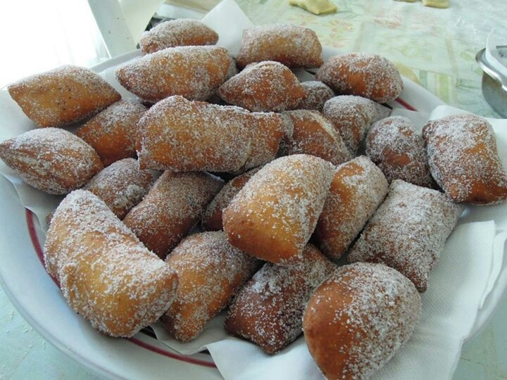 cassatedde (zeppole), traditional Sicilian pastry, fried dough stuffed with sweetened ricotta and rolled in sugar Cefalu, Sicily