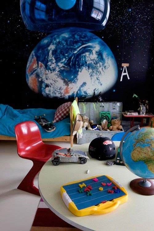 this outer space themed room has a bit of added hipness with the kid sized retro chair