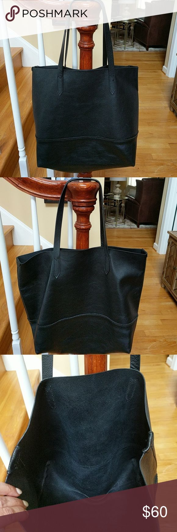 J Crew Downing Tote Nice and roomy J Crew Downing Tote in soft black leather. No hardware so you can wear gold or silver. Measures 17 x 12 x 3. There is some minor wear on bottom corners. In very good condition. J. Crew Bags Totes