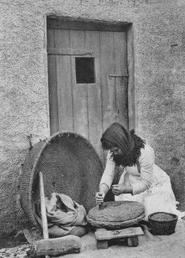Old Scotland: Crofter's wife grinding oats, Isle of Skye.