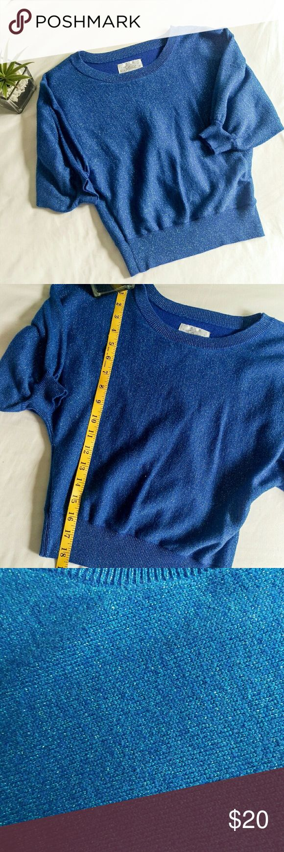 🆕 Girls' Metallic Crop Sweater Girls' royal blue metallic crop sweater from Justice in excellent condition, looks new! Has batwing /dolman style sleeves for a loose fit. I'm not sure how short or long of a crop this is so I've included a picture with length measurement so you can compare it on your child. Justice Shirts & Tops Sweaters
