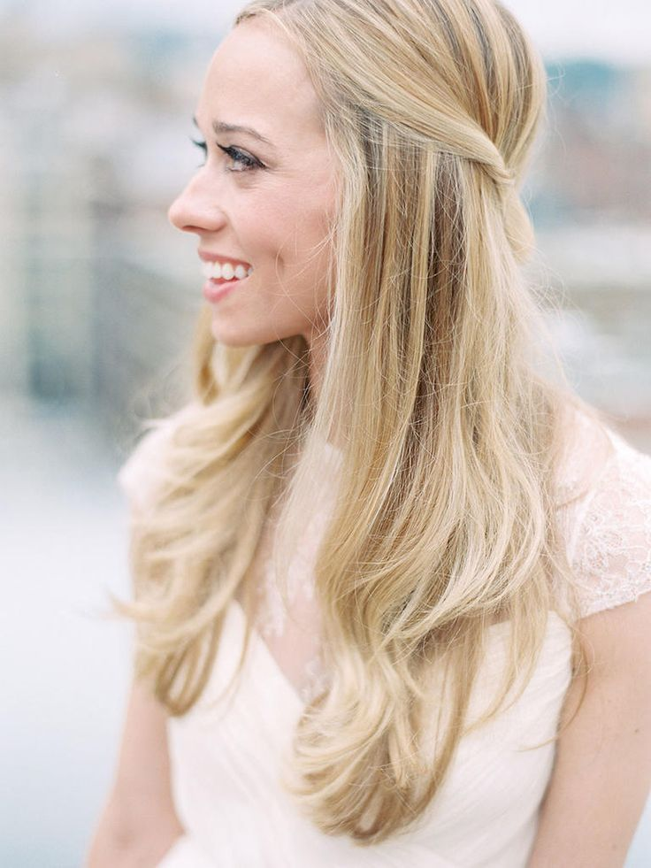 If you prefer your hair down, try this simple, but charming, straight hairstyle with a little blowout sass.