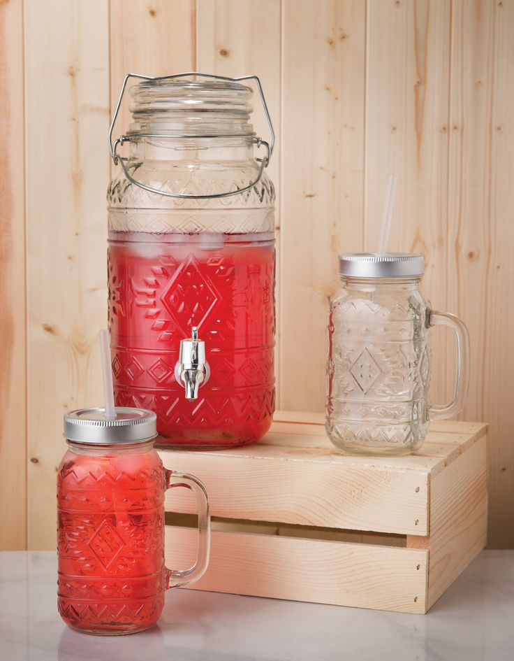 Santa Fe Beverage Dispenser and Mason Jars by Amici Home.  Each item in this collection comes with a beautiful southwestern style pattern and metal accents.  Great for outdoor entertaining.