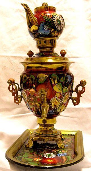 someday i'd like to own a little russian samovar. isn't this one fantastic with the little teapot on top?