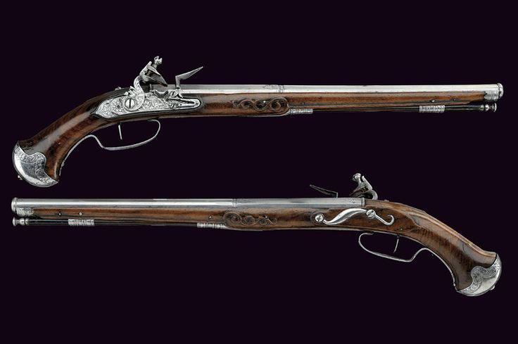 "Flintlock pistols Brescia,17th Century  Long, two-stage, 13 mm cal. barrels, octagonal at the first part signed ""LAZARINO COMINAZZO"" and, after rings, of sixteen faces with moulded muzzle; partially pierced hammers; briarwood full stocks with steel mounts, iron-tipped wooden ramrods with iron cartridge extractor."