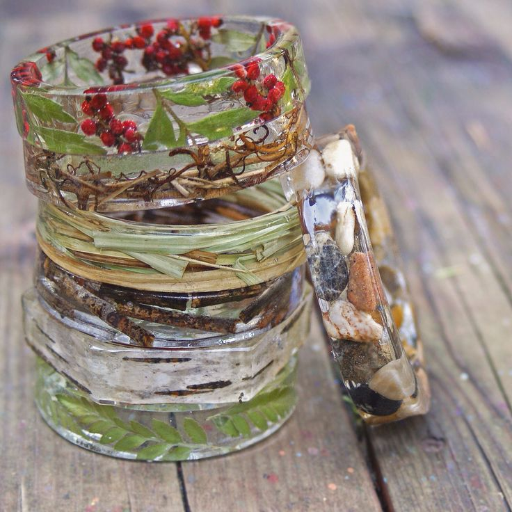 Beautiful resin bracelets with natural element: flowers, pebbles, grasses etc. Very pretty.