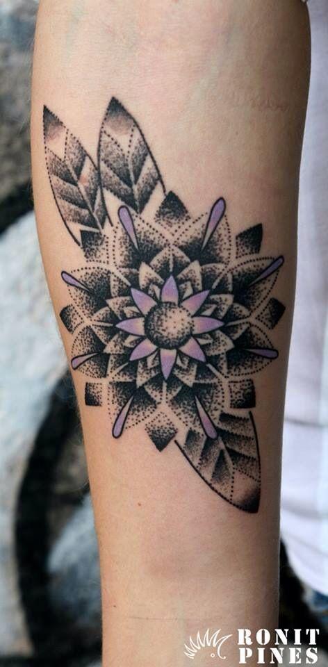 Mandala flower tattoo dotwork