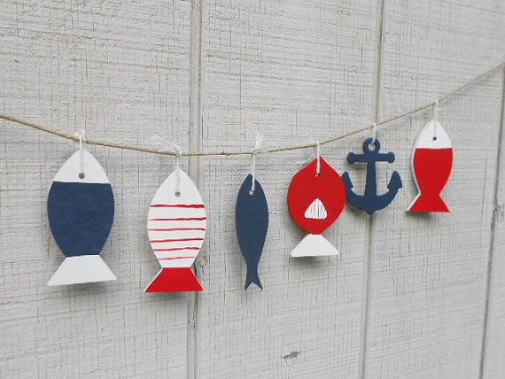 --- But maybe with the letters of his/her name in between the fish --- Nautical Nursery Garland Wooden fish and anchor by TheSeasideKids, $16.00