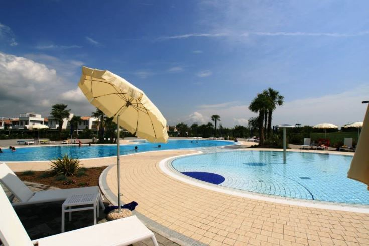 #Sun beds and umbrellas are available around the swimming #pool. #italy