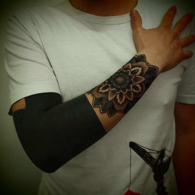 I don't even know why someone would get a huge solid black tattoo like that. Wonder how long it took...