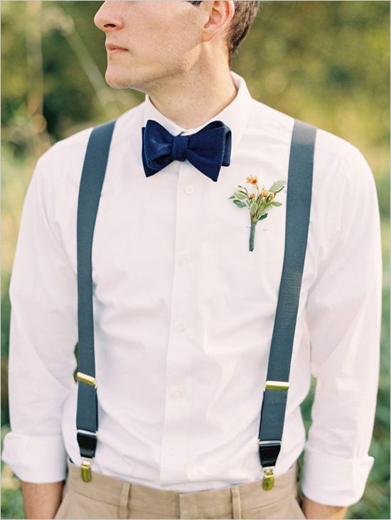 groomsmen style but with dark grey pants and suspenders, white shirt, and emerald green bowtie
